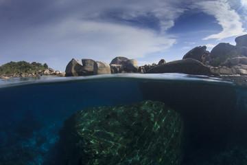 Island, rocks and sea half and half