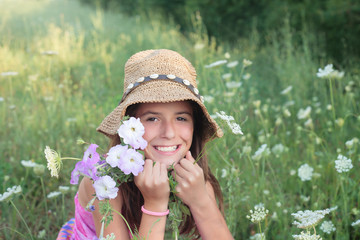 Smiling girl in flower field