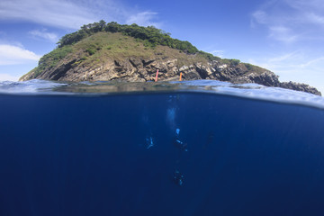 Scuba dive underwater and tropical island