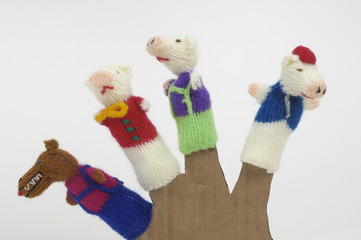 finger puppets on white background