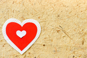 Big red and white heart paper on brown paper background. LOVE and valentines day concept.