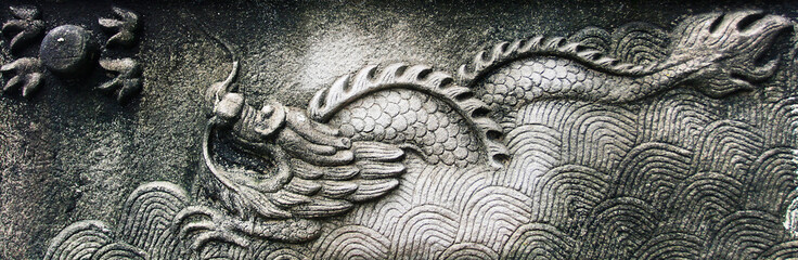 Embossed in stone, Chinese dragon