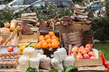 The farm food market. Vegetables, fruits and meat on the market counter.