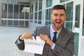 Smiley businessman breaking a contract