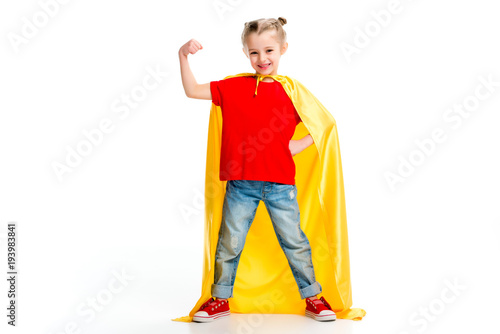 Smiling supergirl in yellow cape showing muscles on hand isolated on white  sc 1 st  Fotolia.com & Smiling supergirl in yellow cape showing muscles on hand isolated on ...