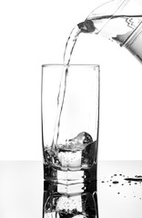 Pour water from a pitcher into a glass