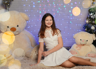 girl with Teddy bear. new year. atelier. snowflakes, glare