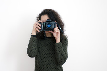Young latin woman with a camera