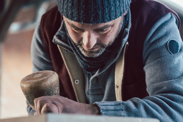 Close up on face of stonemason working with full concentration