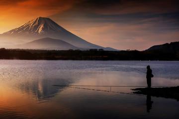 Fishing at lake with Mount Fujisan