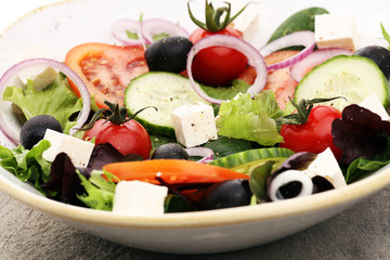 Salad with cheese and fresh vegetables and olives. Greek salad.