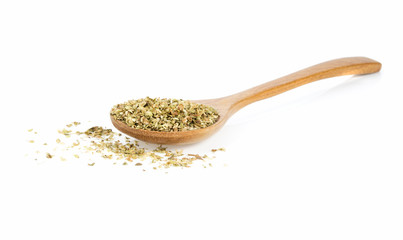 dried oregano in wooden spoon isolated on a white background