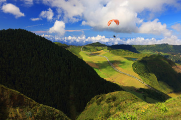 Wall Mural - Paragliding over Sete Cidades, Sao Miguel Island, Azores, Portugal, Europe