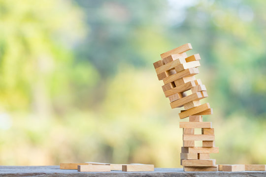 The jenga game ,tower stack from wooden blocks toy and  hand take on block
