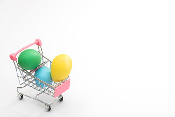 Dyed eggs in a shopping cart, perfect Easter sale, deal, promotional background