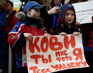 "Children hold a placard reading ""Kovi (Ilya Kovalchuk), smile in exchange for photo"", during a welcoming ceremony for Russian athletes returning back from the Pyeongchang 2018 Winter Olympics, at Sheremetyevo International Airport outside Moscow"
