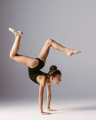 Young gymnast girl stretching and training