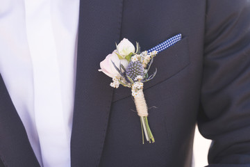 Midsection of bridegroom in suit
