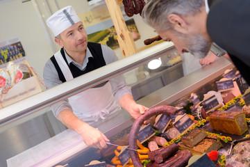 butcher serving a customer