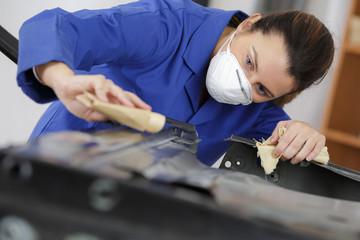 female car polishing  sanding before painting