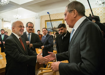 Russian Foreign Minister Sergei Lavrov welcomes his Iraqi counterpart Ibrahim al-Jaafari during a meeting in Moscow