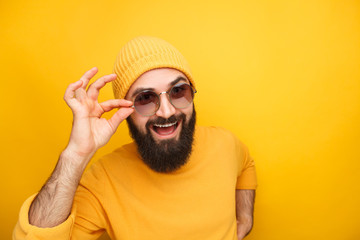 Bright hipster man in trendy sunglasses