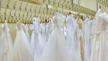 bridal dresses for sale. Stylish elegant wedding dress presented on hangers