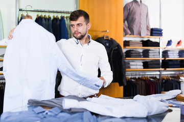 guy  choosing casual jacket