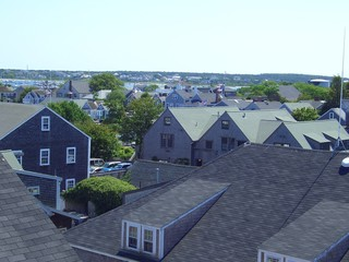 Grey roofs of Nantucket houses on a sunny summer day