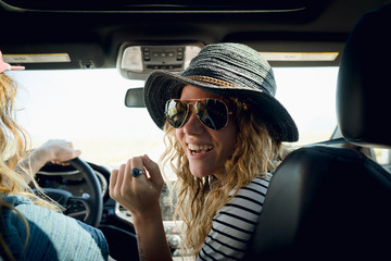 Woman Wearing Sunglasses While Sitting By Man In Car