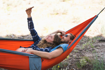 Couple Taking Selfie On Smartphone In Hammock