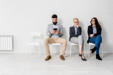 Young modern business people waiting for job interview