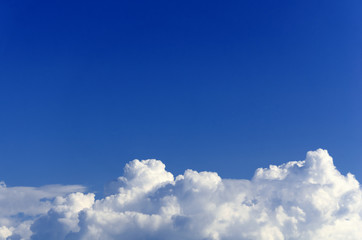 endless blue sky on the background of white fluffy clouds
