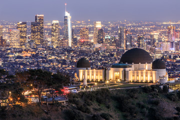 Deurstickers Los Angeles Griffith Observatory Park with Los Angeles Skyline at Dusk. Twilight views of the famous monument and downtown from Santa Monica Eastern Mountains. Los Angeles, California, USA.