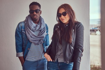 Portrait of an attractive stylish couple. African-American guy w