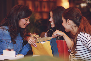 Three after shopping in a cafe