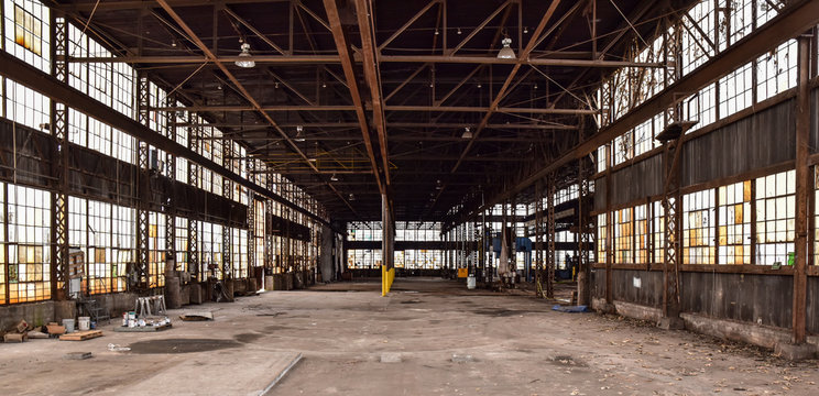 Broken windows in abandoned warehouse industrial space
