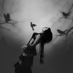 A girl in a black, vintage dress posing against the background of a gloomy forest, which is created by the projector. From her chest bursts the soul, a bird, a symbol of liberation. Play of shadows
