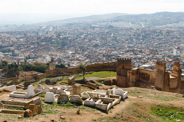 Fez, Morocco aerial view. The ancient city wall is in the foreground and behind it, an overview of the old neighborhood.