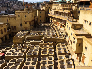 Dye reservoirs in tannery in Fes, Morocco, where the world famous moroccan leather is made