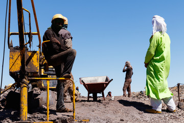 KHAMLIA, MOROCCO: Miners working in surface mine near Sahara desert, Morocco.