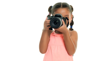 Multiracial small girl taking pictures with a professional camera - Isolated on white