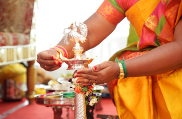 Hindu wedding rituals Traditional south Indian brass oil lamp with people