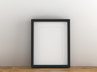 Blank black picture frame template for place image or text inside put on wood table.