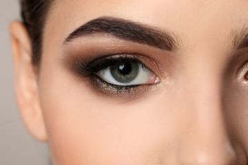 Woman with beautiful makeup, closeup. Professional visage artist work