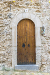 old wooden door in a coastal village of the island of Mallorca in Spain, next to the mediterranean sea, vacation and rest concept