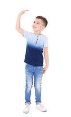 Little boy measuring height on white background