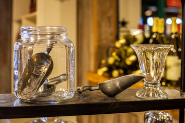 Shelf with glass jar and metal candy scoops