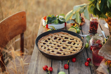 Close-up of cherry pie in container on wooden table