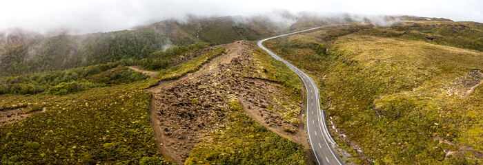 Aerial Panorama of windy road through volcanic landscape